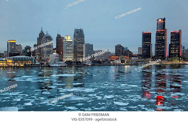 Chunks of ice float along the Detroit River with passing the skyline of downtown Detroit, Michigan, USA. - DETROIT, MICHIGAN, USA, 19/03/2015