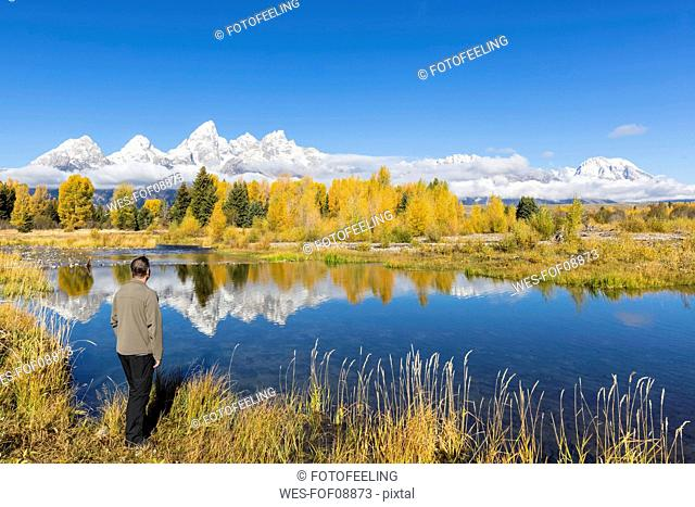 USA, Wyoming, Rocky Mountains, Grand Teton National Park, Cathedral Group, tourist at Snake River