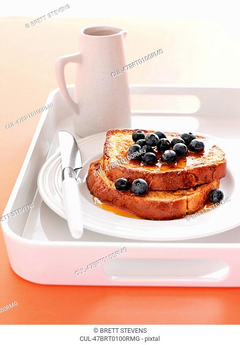 Toast with blueberries and honey