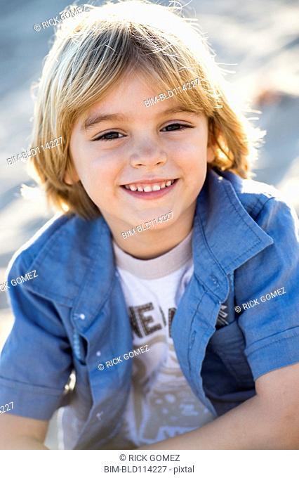 Hispanic boy smiling outdoors