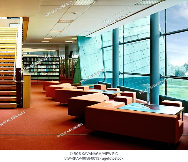 Galway-Mayo Institute of Technology, Galway, Ireland. Architect: Murray O'Laoire, 2003. View of seating area in library showing stairs, shelving
