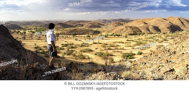 Man looking out at Huab River [Composite Panorama Image] - Huab Under Canvas, Damaraland, Namibia, Africa