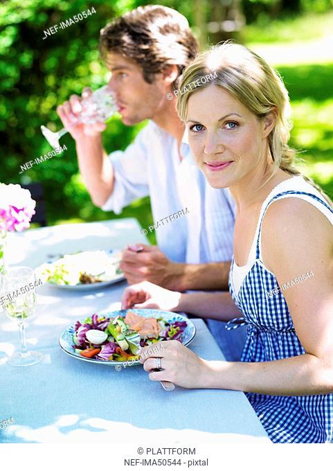 Couple having dinner in the garden, Stockholm, Sweden