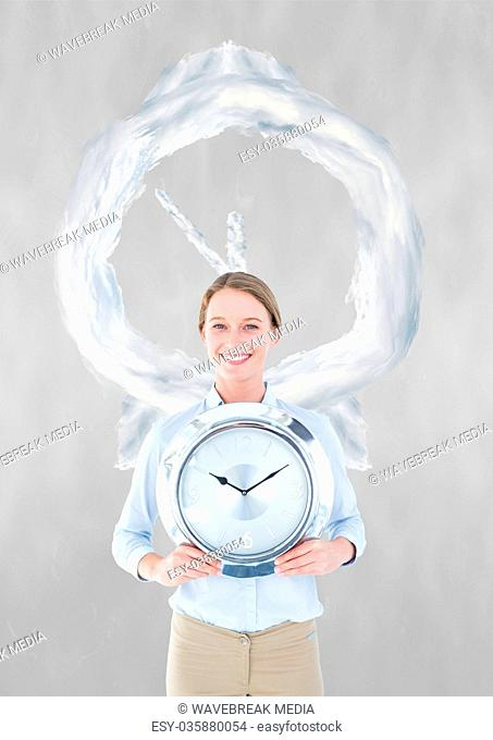 Business woman holding a clock against background with clock