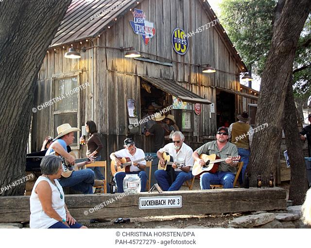 Guests of the bar in Luckenbach play guitars under some trees in Luckenbach (Texas), USA, 19 March 2013. German is spoken in the middle of Texas