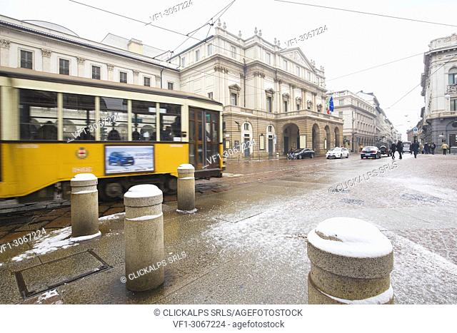 Transit of a traditional tram in front of Scala Theater. Milan, Lombardy, Northern Italy, Italy
