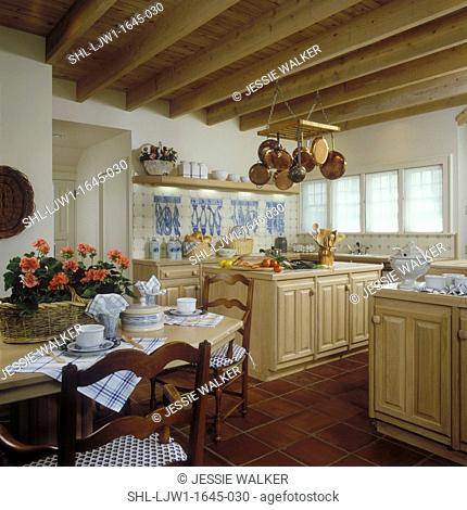 KITCHEN - Traditional kitchen overall with eating area, square tile floor, tiled blue and white backsplash, fish on tile, copper pots , hanging pot rack