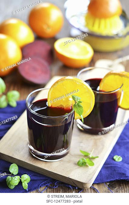 Beetroot and orange juice in glasses