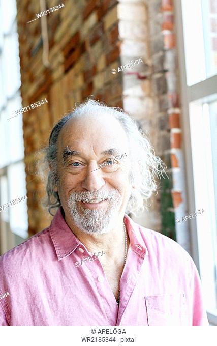 Portrait of happy senior man in gym
