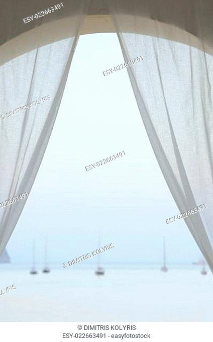sailboats by the sea at sunset
