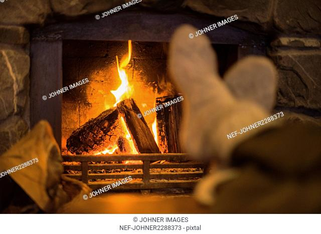 Feet near fireplace