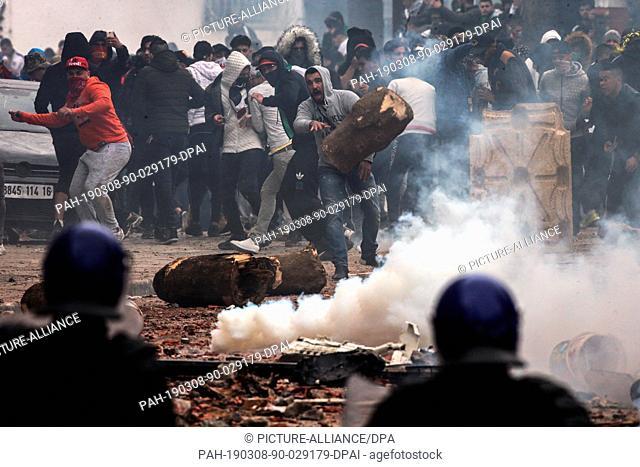 08 March 2019, Algeria, Algiers: Algerian riot police clashes with protestors demonstrating against Algerian President Abdelaziz Bouteflika