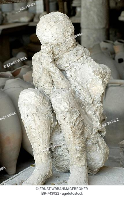 Plaster cast of a dying man in the forum granary, Pompeii, archaeological site near Naples, Campania, Italy