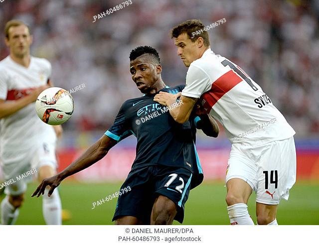 Stuttgart's Philip Heise (R) and Manchester's Kelechi Iheanacho vie for the ball during a friendly between German Bundesliga soccer club VfB Stuttgart and...