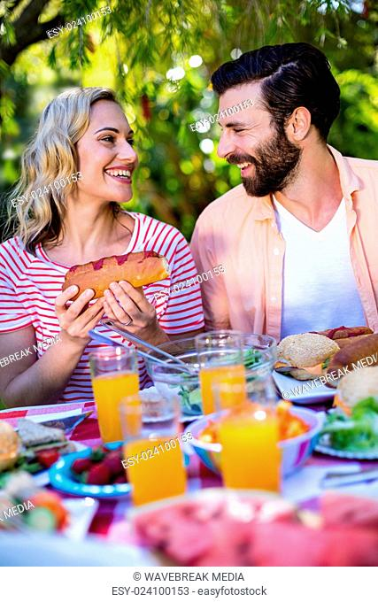 Couple enjoying breakfast in yard