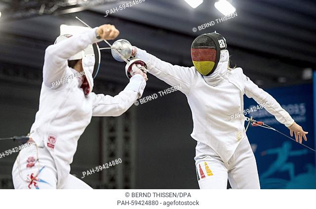 Germany's Britta Heidemann (R) competes with Lis Fautsch of Luxemburg in the Fencing - Women's Individual Epee Pool Round at the Baku 2015 European Games in...