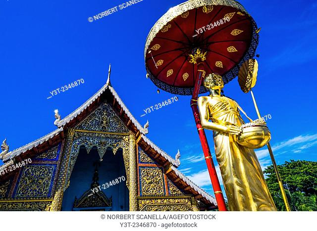 Asia. Thailand, Chiang Mai. Wat Phra Singh.Golden statue of a revered monk