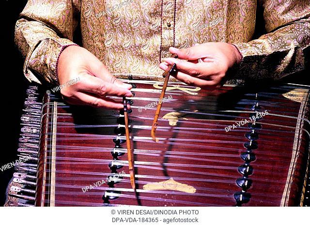 man playing musical Instrument santoor India