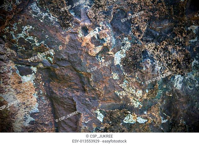 Stone dark brown in color with a rough surface cracked
