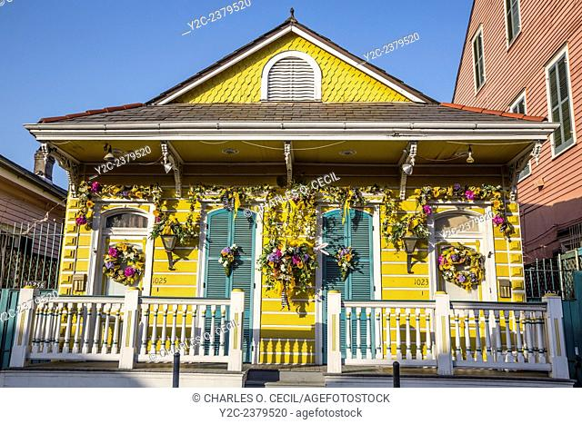 French Quarter, New Orleans, Louisiana. Double Shotgun House with Porch and Flower Decorations