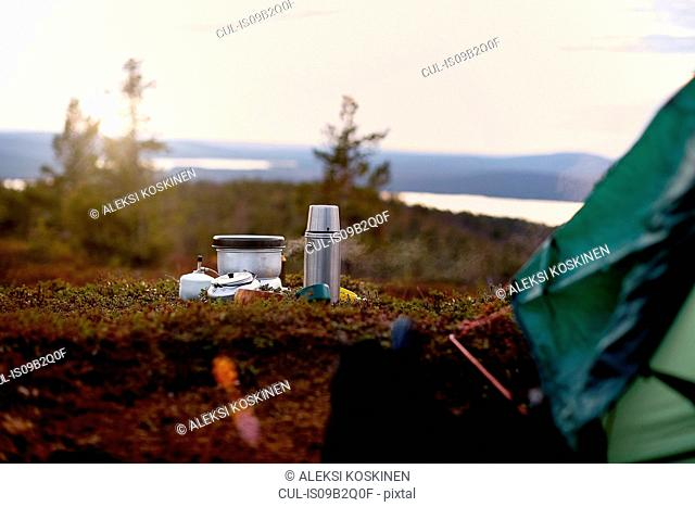 Cooking pot and coffee flask in front of tent, Keimiotunturi, Lapland, Finland