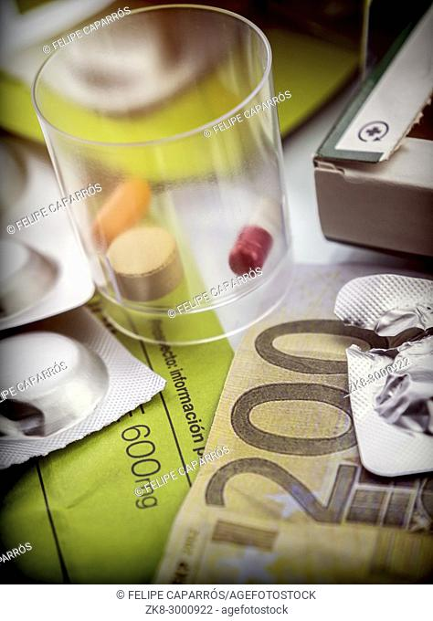 Some medicines along with a ticket of 200 euros, conceptual image copay health