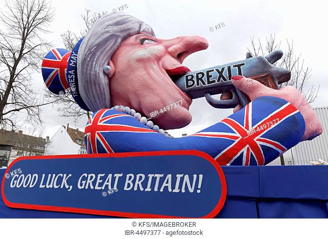 British Prime Minister Theresa May holds gun in her mouth, suicide by Proposed referendum on United Kingdom membership of the European Union, paper mache figure