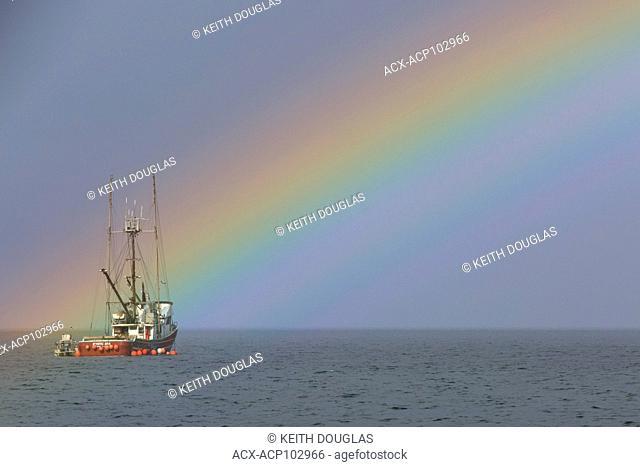 Fishing boat and rainbow, near Nanaimo, Vancouver Island, British Columbia
