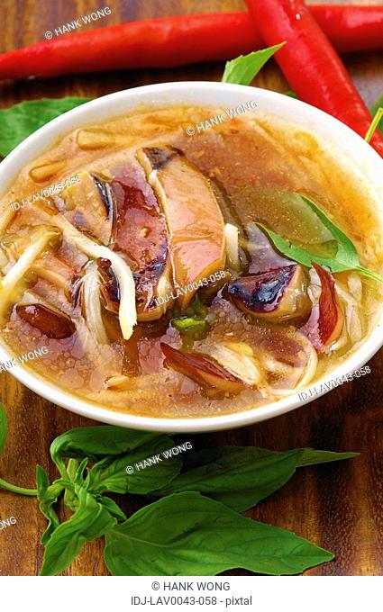 High angle view of Oriental squid and noodle soup