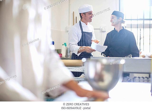 Chefs chatting in kitchen