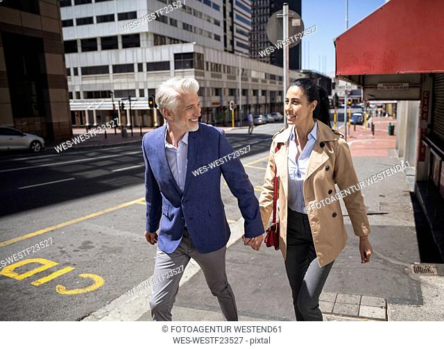 Mature couple walking in the city