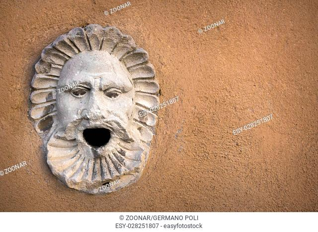 Sculpture of a face with open mouth