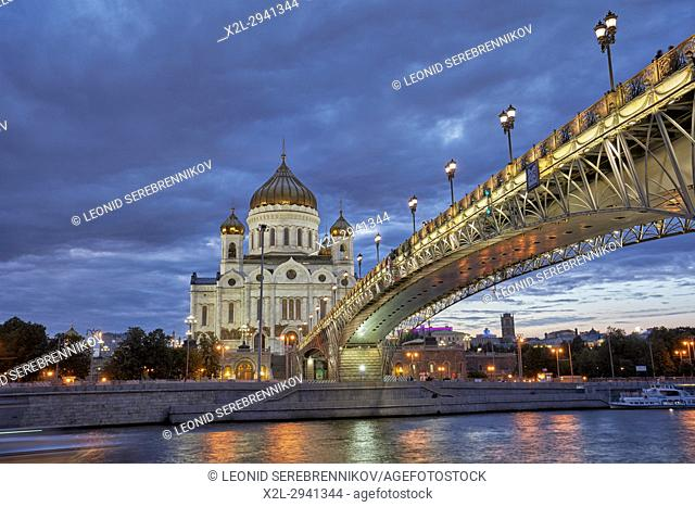 Cathedral of Christ the Saviour and Patriarch's Bridge illuminated at dusk. Moscow, Russia