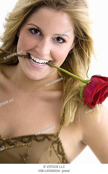 Woman with a rose in her mouth