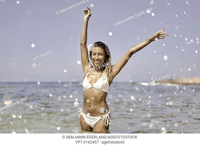 Woman in sea, beach, holiday, Crete, Greece
