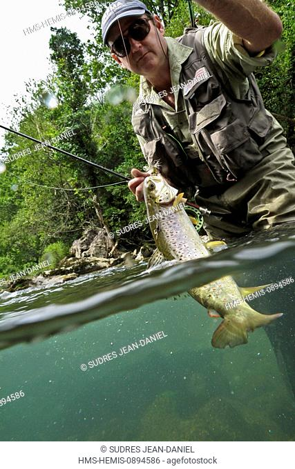 France, Pyrenees Atlantiques, Basque Country, near Esterencuby, learning fly fishing to whip Yvon Zill, monitor fishing guide who organizes fishing courses in...