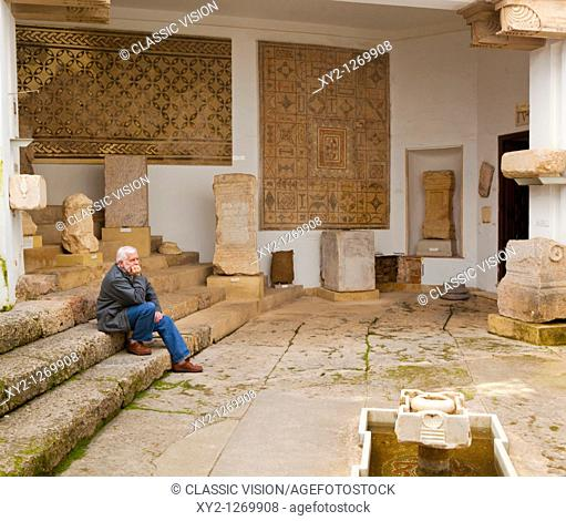 Visitor contemplating Roman antiquities in Museo arqueologico y etnologic, Cordoba, Cordoba Province, Spain  Archeological and Ethnological Museum