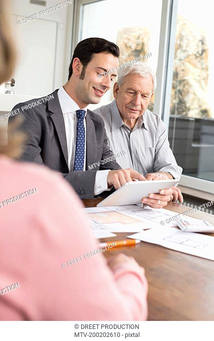 Consultant advising couple at home