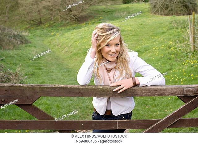 Beautiful young woman enjoying being outside in a green natural environment