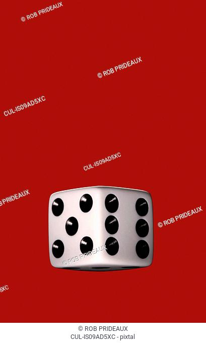 Still life of dice with red background