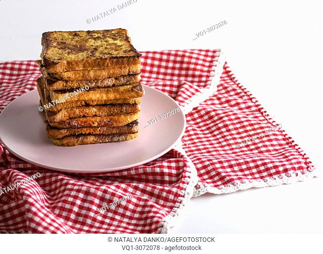 fried French toast on a ceramic pink plate, copy space