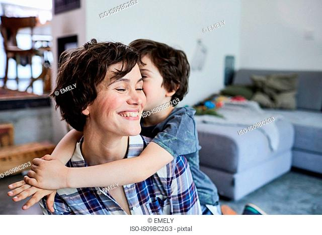 Mother and son at home, son hugging mother