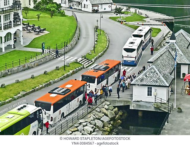 Tour busses cue up at the dock in Eidfjord, Norway as cruise passangers wait to board for excursions
