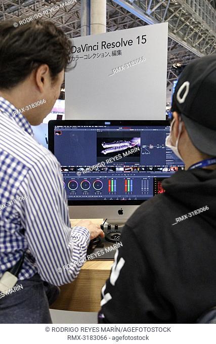 November 15, 2018, Tokyo, Japan - Visitors tests the new color correction software DaVinci Resolve 15 during the International Broadcast Equipment Exhibition...
