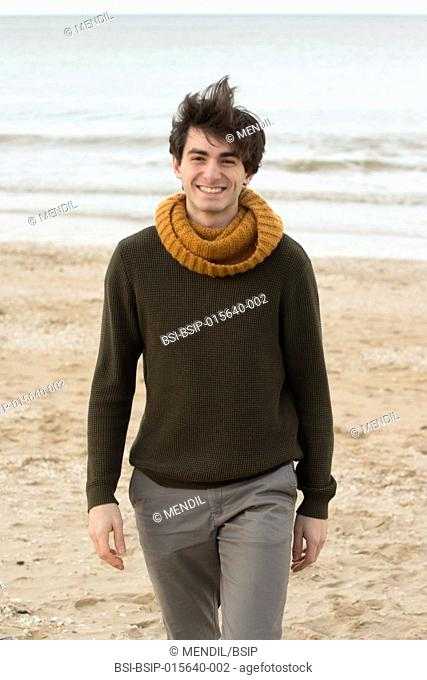 Man strolling on the beach