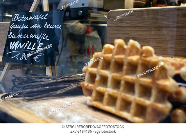 A showcase of a bakery with vanille wafles advertisement, Brussels, Belgium. Another Belgian waffles are typical sweets. There are three varieties of Belgian...
