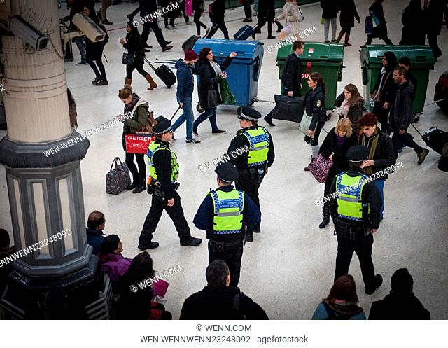 CCTV cameras in Victoria Station look on from above as the Metropolitan Police post more officers in Underground Stations following the suspected terrorist...