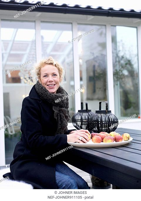 Woman with apples, Sweden