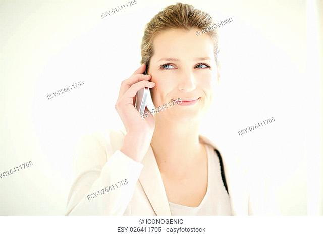 Young Caucasian businesswoman talking on phone