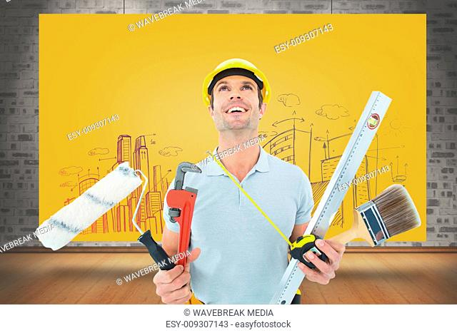 Composite image of worker holding various equipment over white background
